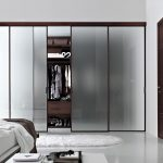 wonderful master bedroom idea with frosted glass covered walk in closet design with brown accent and glass window