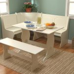 wonderful white dining room design with small table and banquette and bench and stripe patterned area rug
