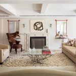 wondrous media room design with fireplace and creamy sofa idea and furry rug and brown leather wing chair and white ceiling