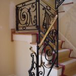 wrought iron stair railings interior with golden touch on its edge plus wooden staircases covered with rug