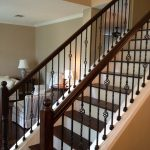 wrought iron stair railings interior with wooden accents on its holders for home ideas