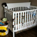 yellow-monkey-with-brown-line-storage-bin-by-3-sprouts-for-many-dolls-near-white-wooden-crib-with-light-brown-wall-and-dark-wooden-floor