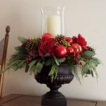 A Christmas centerpiece idea with clear glass vase for candle bar