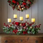 A Christmas wreath and an arrangement of Christmas decoration with candles