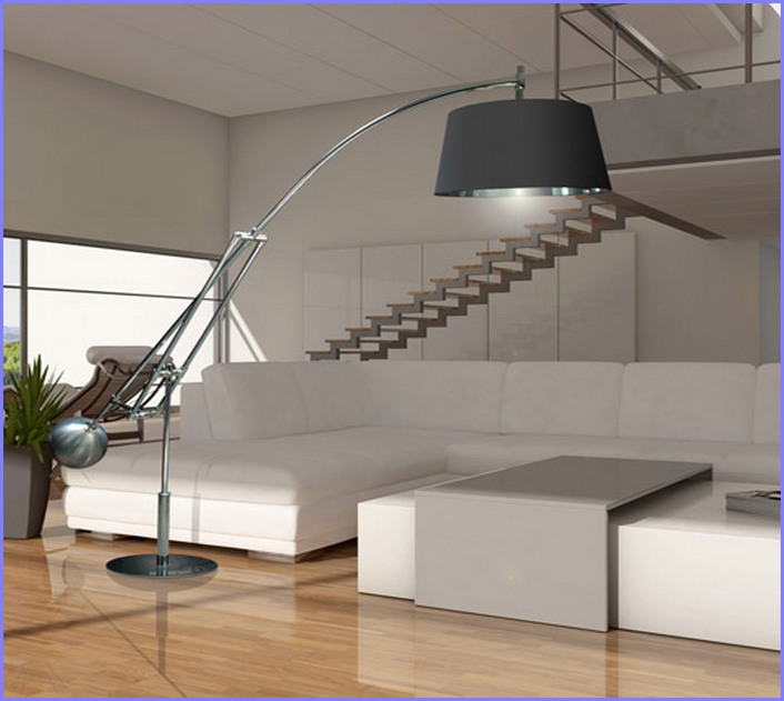 A floor lamp with metal base and oversized black lamp shade