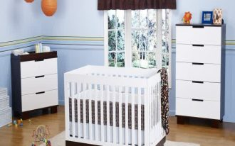 A unit of baby crib in white color two units of white drawer systems medium sized bedroom rug in white
