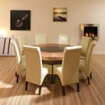 Amazing Design Of 8 Person Round Dining Table With White Elegant Chairs And Room With Frames