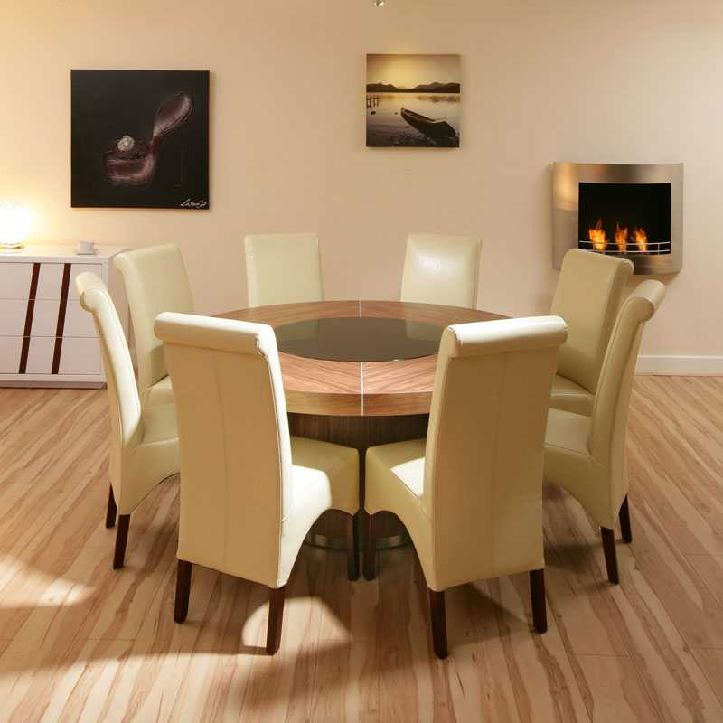 round dining table with white elegant chairs and room with frames