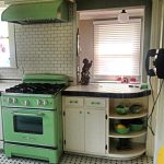 Antique Looking Stoves Set With Green Color And Storage Place