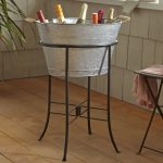 Big Grey Beverage Bucket With Stand In Room With Hardwood Floor