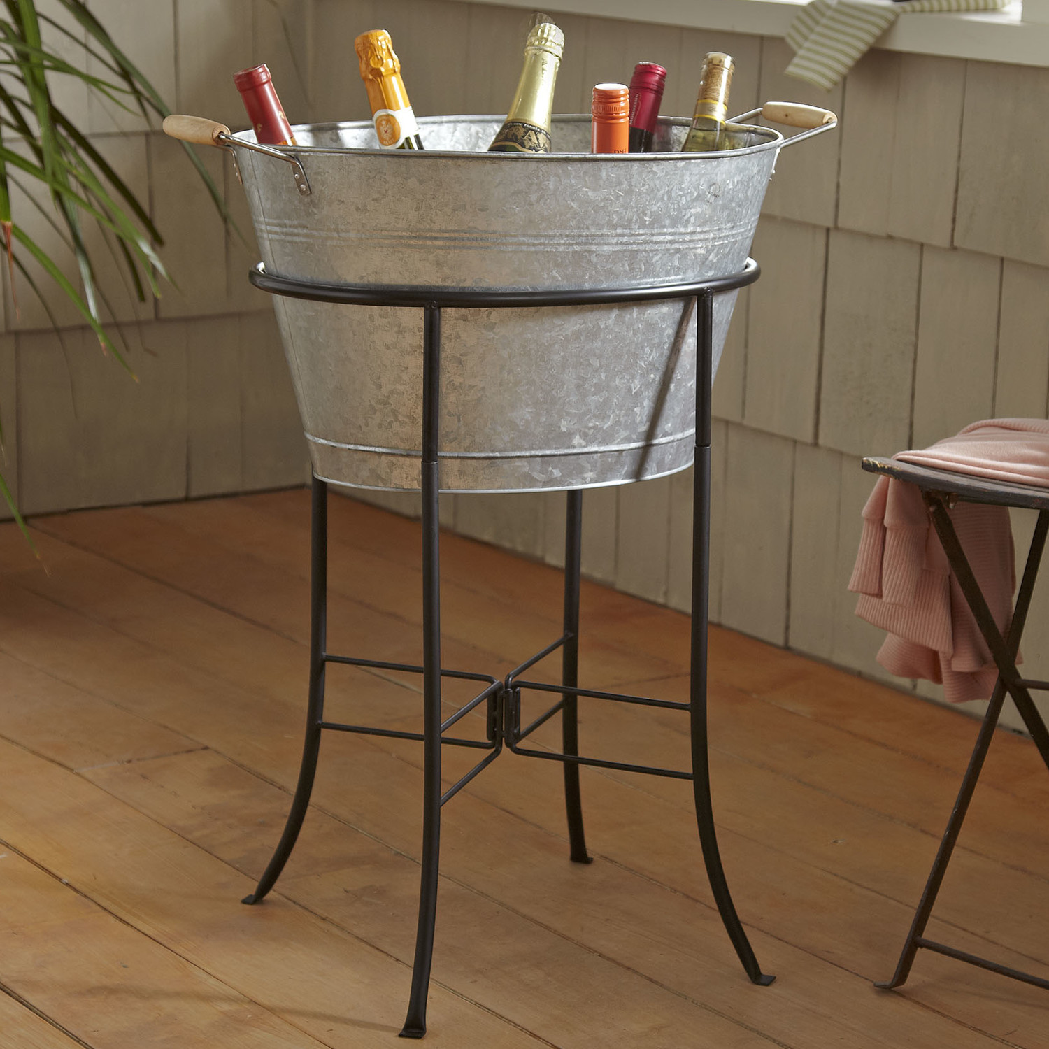 Beverage Stand Related Searches: From bottles of wine to bottles of beer, the 5-Gallon Solid Copper Etched Beverage Tub with Stand by Old Dutch International keeps your beverages cold and the party going. This versatile tub also functions as bin for storing kindling wood.