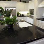 Black Quartzite Countertops Pros And Cons With White Kitchen Cabinet And Chairs
