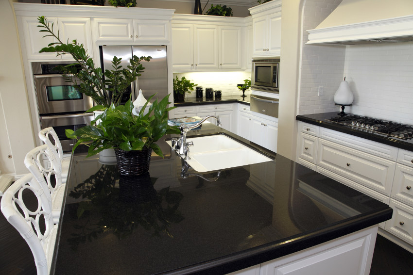 Gentil Black Quartzite Countertops Pros And Cons With White Kitchen Cabinet And  Chairs