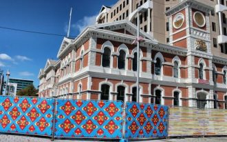 Blue decorative fencing system with red and yellow diamond cut motifs