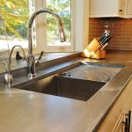Bluestone Of Quartzite Countertops Pros and Cons With Grey Metal Sink And White Cabinet