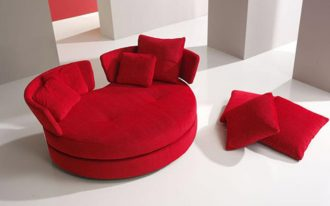 Bright red love seat in small size and round shape