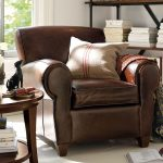 Brown Leather Recliner With Pillow And Round Wooden Side Table