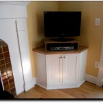 Built in TV stand at the corner of room