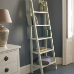 Charming Rustic Ladder Shelving Unit With White Wooden Cabinet And Table Lamp