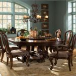 Classic Dining Room With Wooden 8 Person Round Dining Table Antique Chandelier And Decorative Carpet