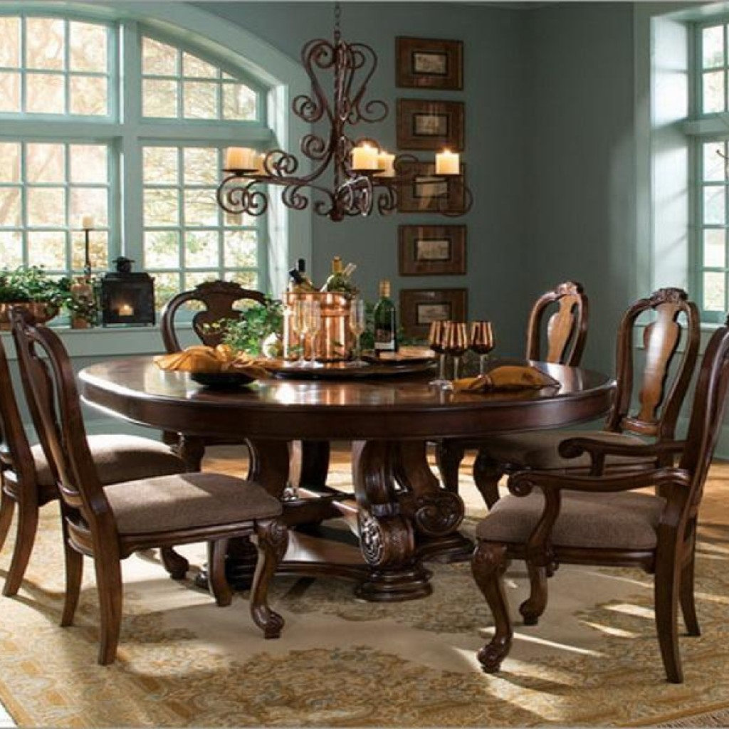 Classic Dining Room With Wooden 8 Person Round Table Antique Chandelier And Decorative Carpet