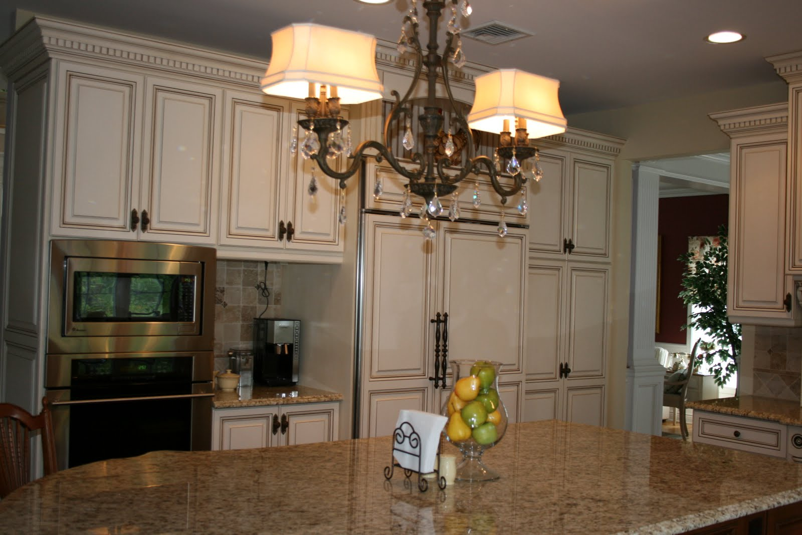 Classic Kitchen Makeovers On A Budget With Double Lights Of Chandelier  Marble Kitchen Island And White