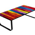 Colorful wood planks table top with wrought iron legs