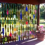 Cool decorative fence idea made of unused bottles