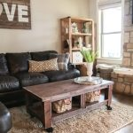 Cool shabby wood coffee table with baskets in modern rustic style