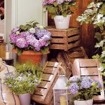 Creative plant pot stand idea which is made of wine crate pile