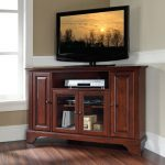 Dark brown finished wooden TV table with under glass door rack and cabinets for corner area