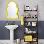 Dark finished wood ladder shelf idea for bathroom free standing bathroom sink with yellow framed vanity mirror