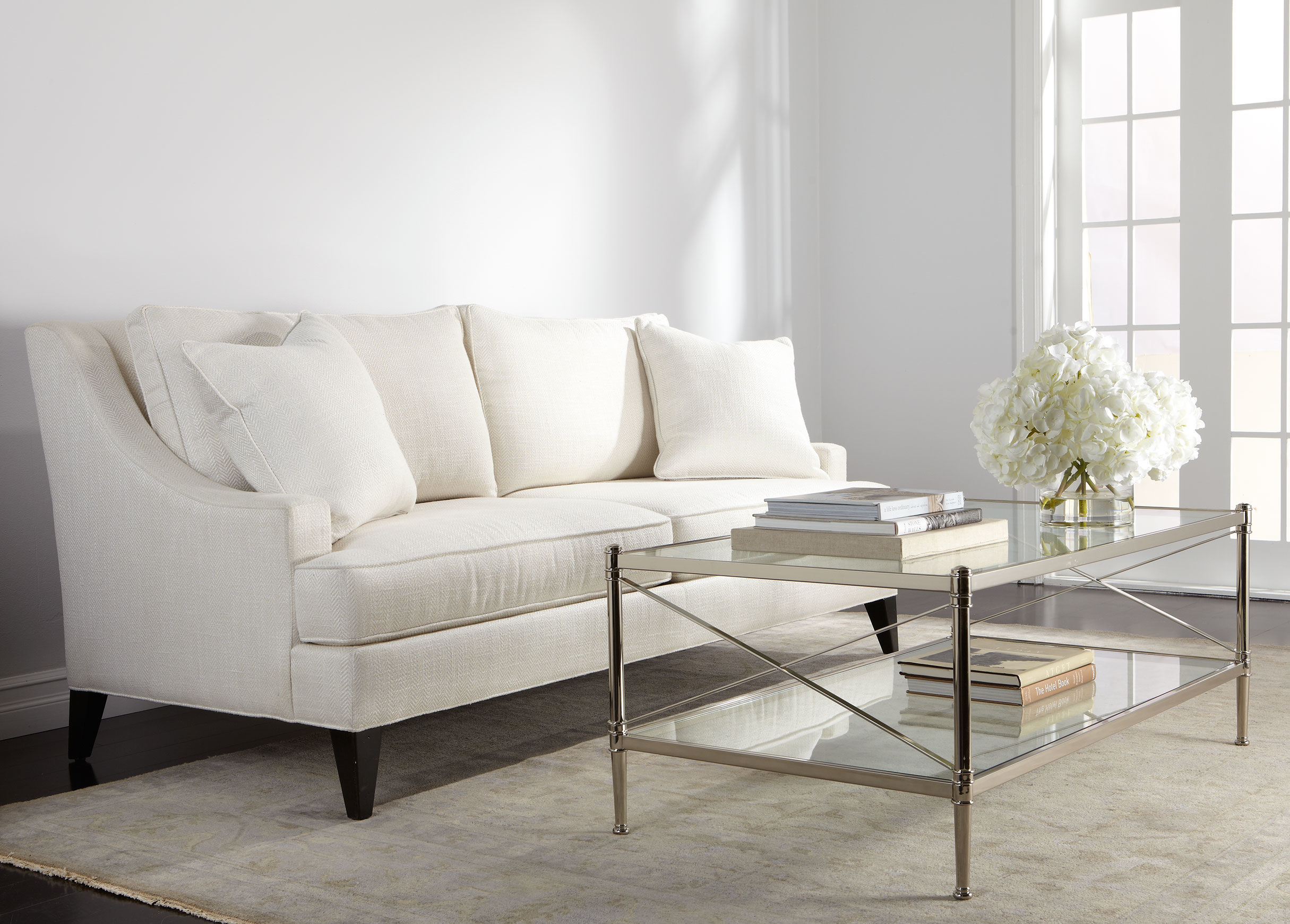 Elegant White Ethan Allen Sleeper Sofas With Pillows And Glass Coffe Table  Plus Large Rug