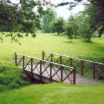Flat surface metal bridge for garden with two side hand rails