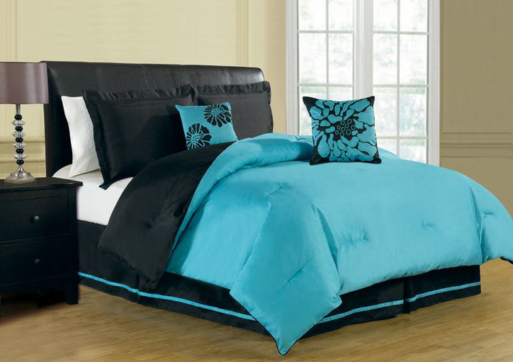 Full Sized Bed Frame With Black Leather Headboard And Reversable Turquoise Comforter