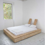 Full sized platform bed frame with a pair of unique small headboards thin mattress with white bed sheet