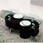 Funky and cool coffee table with clear glass top and glossy black base