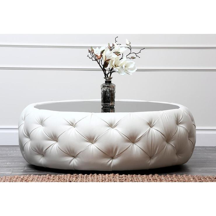 Glass Top Ottoman Coffee Table In Round Shape And Covered By Tufted White  Leather