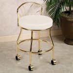 Gold colored makeup vanity chair idea with white cushion and casters