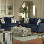 Home Furnishing Catalogs For Living Room With Double Dark Blue Sofa And Stripped Pillows Plus Stylish Ottoman And Rug