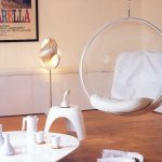 Indoor clear hang chair with white cushions