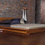 Low platform bed frame with headboard in modern style