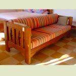 Low profile wood framed couch in strip motif