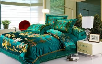 Luxurious turquoise bed comforter set with gold scheme pattern modern white bedside table with drawers and white table lamp with white lampshade