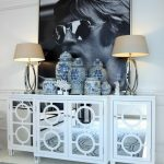 Luxury White Mirrored Media Console With Double Table Lamps Vases And Big Frame