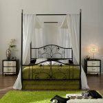 Metal Iron Canopy Bed Frame With White Curtains And Green Bed Rug