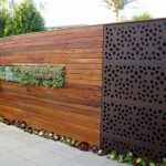 Mix wood and metal decorative fencing system with decorative green plants