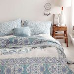 Modern And Elegant Urban Outfitter Bedding With Pillows And Wooden Side Table Plus White Table Lamp