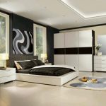 Modern Bedroom With Low Profile Bed White Wardrobe And Cabinet Plus Art Frame On Wall Of Home Furnishing Catalogs