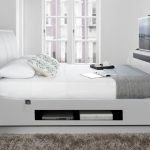 Modern White Beds With Built In TV And Storage Place Plus Fur Rug And White Trunks